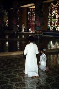 Two followers of Caodism praying. ... August 12, 2004 ... Copyright Robert Page III
