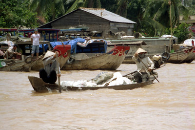 Paddling in the Mekong Delta. ... August 13, 2004 ... Copyright Robert Page III