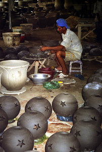 A man molding clay pots that are sold at American gardening centers. There is a lot of clay in the area of the Mekong Delta.  The clay also allowed  the Vietcong to construct their tunnels. ... August 13, 2004 ... Copyright Robert Page III