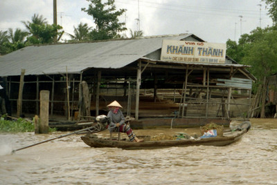 A Vietnamese taking her goods to market in the Mekong Delta. ... August 13, 2004 ... Copyright Robert Page III