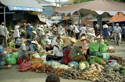 A street market with tons of vegetables and other delicacies.  One of the girls I was walking with had me try a fruit and it was really good.  She ate it while she was volunteering in Cambodia for a couple months. ... August 13, 2004 ... Copyright Robert Page III