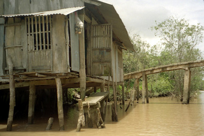 A house along the water in the Mekong Delta. ... August 13, 2004 ... Copyright Robert Page III