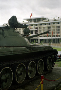 A tank rests outside the Reunification Palace as a reminder that this was once a place of war and that the North Vietnamese tanks stormed this compaund when they fianlly took all of Vietnam and united it. ... August 11, 2004 ... Copyright Robert Page III