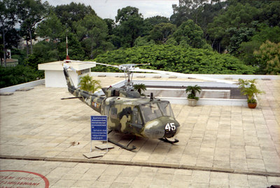 An army helicopter sits on the roof of the Reunification Palace like may did during the Vietnam War. ... August 11, 2004 ... Copyright Robert Page III