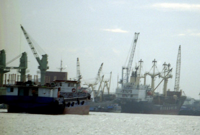 Ships waiting to be unloaded along the Mekong in Ho Chi Minh City. .. August 11, 2004 ... Copyright Robert Page III