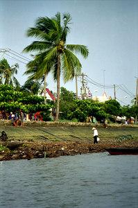 A Vietnamese scavenging along the banks of the Mekong. ... August 11, 2004 ... Copyright Robert Page III