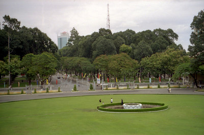 The view out the fron of the Reunification Palace onto the city of Ho Chi Minh (Saigon).  Notice the modern skyscraper in the background. ... August 11, 2004 ... Copyright Robert Page III
