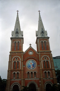 Notre Dame of Ho Chi Minh City.  It was built between 1877 and 1883.  Due to the Vietnam War there are no stain glass windows.  Unfortunately, outside there were many beggars. ... August 11, 2004 ... Copyright Robert Page III
