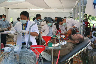 The dental clinic set up under a tent at the base of Budda's temple.  This pic is for you mom!