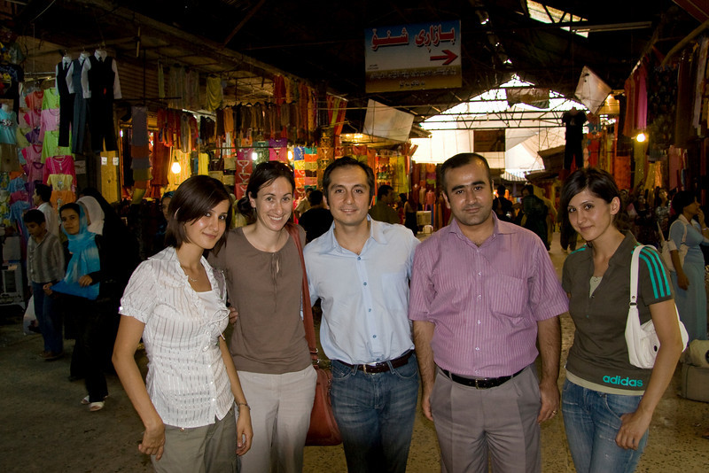 In the bazaar, dawn, Amir, and Dr. Saman with his nieces