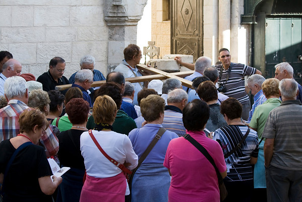 Praying at a Station of the Cross