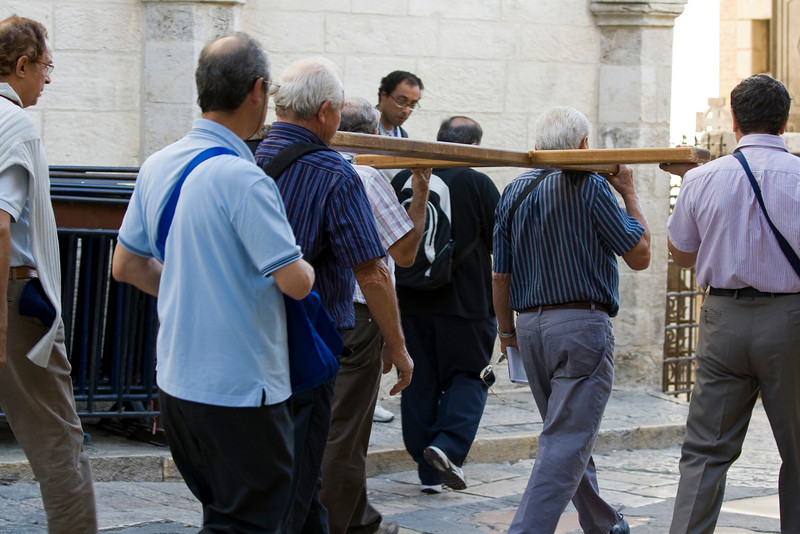 Christian group carrying a cross through Jerusalem