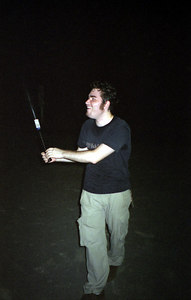 Marcus Arrajj playing baseball at night in the Mitsuzawa park near the Kato family's house.  We bought the plastic bat and ball at the local convenience store while at Masashi Kato's sayonara party...July 17, 2004...Copyright Robert Page III