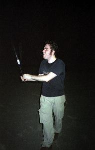Marcus Arrajj playing baseball at night in the Mitsuzawa park near the Kato family's house.  We bought the plastic bat and ball at the local convenience store while at Masashi Kato's sayonara party...July 17, 2004...Copyright Robert Page III
