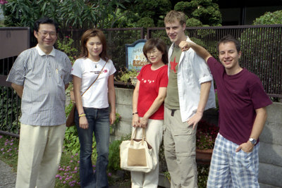 Saying goodbye to the Kato's at their house.  Papa-Yasuko-Mama-Me-Michael Ruprecht. ... July 25, 2004 ... Copyright Robert Page III