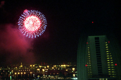 A fireworks display over the city of Yokohama.  This is from the Moriyama's apartment on the 25th floor of the Minato Mirai apartment complex. ... July 18, 2004 ... Copyright Robert Page III