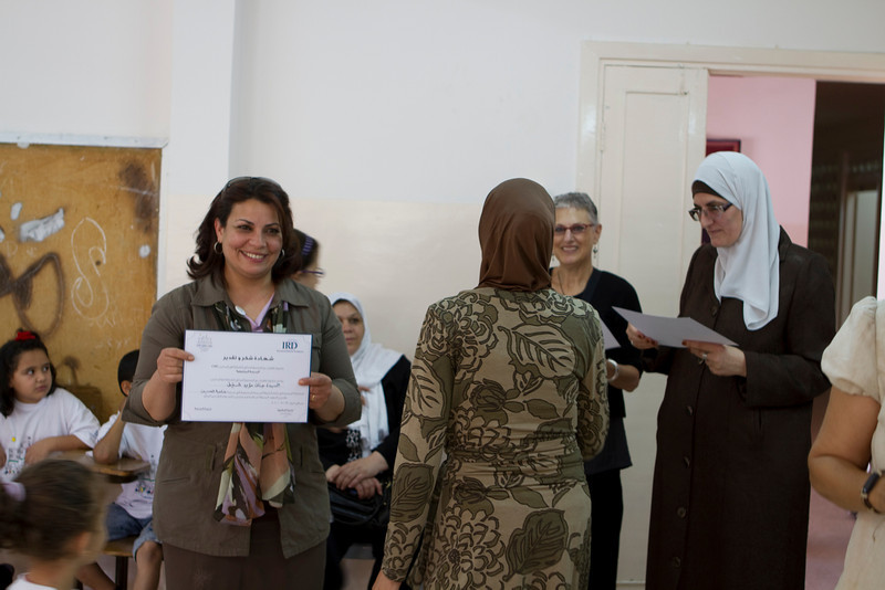 Susan and the Principle passing out certificates of appreciation to the mothers who helped implement the summer club at the school.