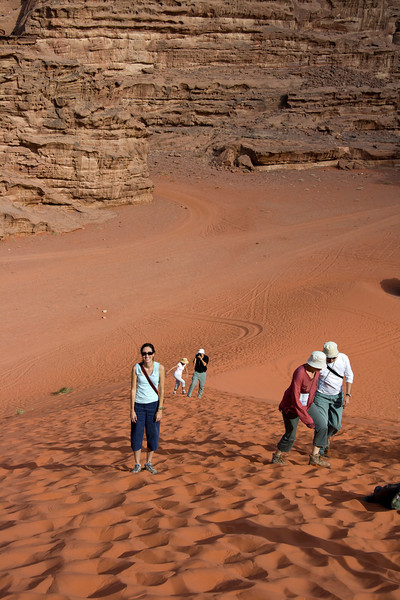 Climbing the sand dune in the middle of the Wadi Rum Desert
