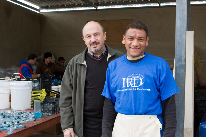 Shamil, our Program Director, with one of the participants in the recycling class