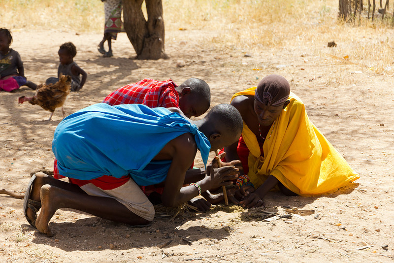 The young Maasai warriors start a fire at Samburu National Reserve - Kenya