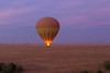Hot-air balloon ride over Masai Mara plains at dawn.