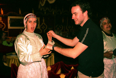 Elliot, what did you do to this girl?  Fantasia Chez Ali  - Marrakesh, Morocco ... March 7, 2005 ... Photo by Heather Page