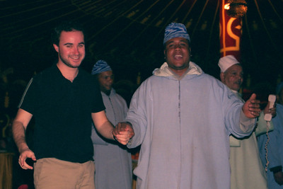 Elliot, you were doing so well with the girls and now you are dancing with a large man holding a telephone - Marakesh, Morocco ... March 7, 2005 ... Photo by Heather Page