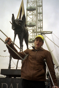 The London Eye is off its moorings and the elephant by Dali is running after Pedro.  His crutches aren't going to help him to the front of the line here - London, England ... March 4, 2005 ... Photo by Rob Page III