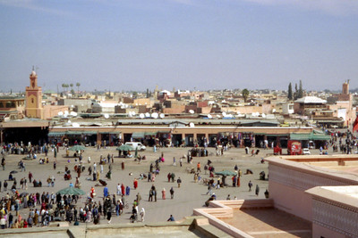 Djamaa el Fna. The large main square of Marrakesh. It's been called the world's most exciting gathering place.  During the day it is full of shops and at night the acrobats, snake charmers, and entertainers come out - Marrakesh, Morocco ... March 7, 2005 ... Photo by Rob Page III