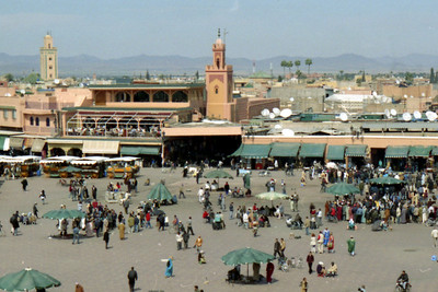 Djamaa el Fna. The large main square of Marrakesh. It's been called the world's most exciting gathering place.  During the day it is full of shops and at night the acrobats, snake charmers, and entertainers come out - Marrakesh, Morocco ... March 7, 2005 ... Photo by Heather Page