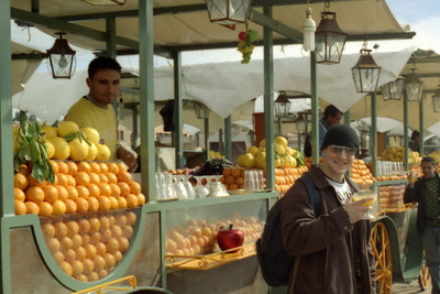 Jordan enjoying his orange juice on the Djamaa El Fna - Marrakesh, Morocco ... March 7, 2005 ... Photo by Heather Page