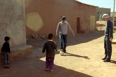 Pedro and Rob playing soccer with the locals - Aït Ben Haddou, Morocco ... March 8, 2005 ... Photo by Heather Page