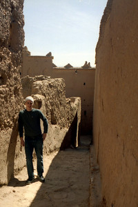 Rob just leaning against the mud wall in this old Moroccan town- Aït Ben Haddou, Morocco ... March 8, 2005 ... Photo by Heather Page