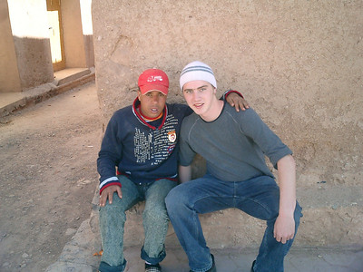 Rob chilling with a friend that he made playing soccer.  Marselle took us through the back street of Ouarzazate and showed us some Jewish houses as well as a mosque - Ouarzazate, Morocco ... March 8, 2005 ... Photo by Pedro Mendoza