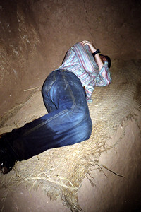 Pedro's new dorm bed.  His feet are wet because he didn't want to pay to cross the river - Aït Ben Haddou, Morocco ... March 8, 2005 ... Photo by Rob Page III