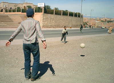 Pedro kicking the ball around with the locals.  Ouarzazate is Morocco's Hollywood - Ouarzazate, Morocco ... March 8, 2005 ... Photo by Heather Page