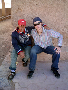 Pedro chilling with a friend that he made playing soccer.  Marselle took us through the back street of Ouarzazate and showed us some Jewish houses as well as a mosque - Ouarzazate, Morocco ... March 8, 2005 ... Photo by Rob Page III