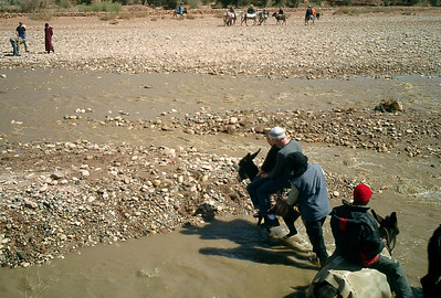 Crossing the river by donkey.  The poor donkey could barely support our weight - Aït Ben Haddou, Morocco ... March 8, 2005 ... Photo by Travis
