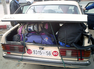Cramming all our luggage into the taxis was a challenge - Marrakesh, Morocco ... March 7, 2005 ... Photo by Rob Page III