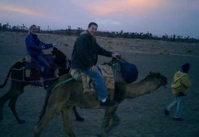 The bouncing camal made photos in the twilight difficult, but as you can see people are having fun.  Ask Jordan about his experiences with the hump though - Zagora, Morocco ... March 8, 2005 ... Photo by Rob Page III