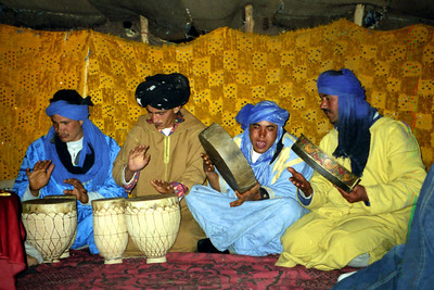 Drumming with the Berbers (The local people)  We are in the tent here, but later we went out onto the dunes - Zagora, Morocco ... March 8, 2005 ... Photo by Rob Page III