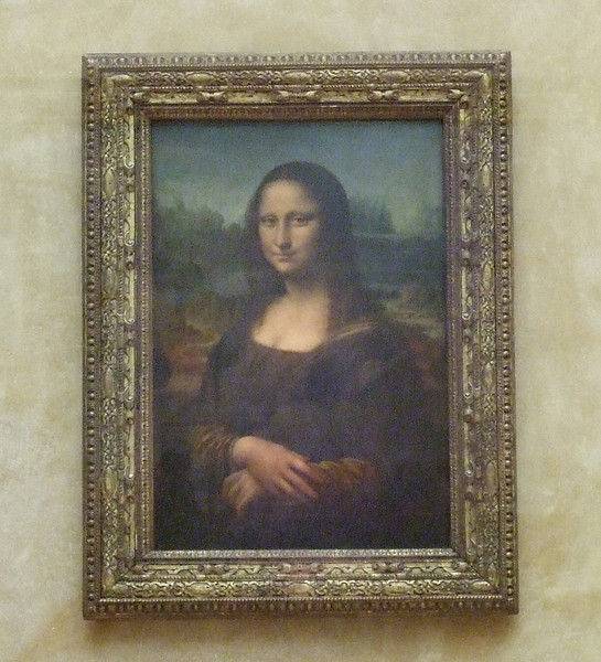 Mona Lisa behind her protective cover at the Louvre