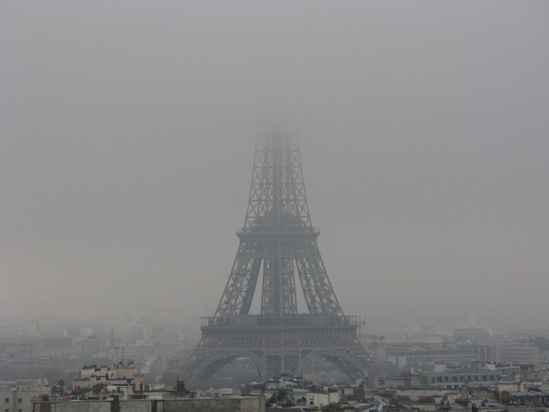 The Eiffel Tower fogged In from the top of the Arc de Triomphe