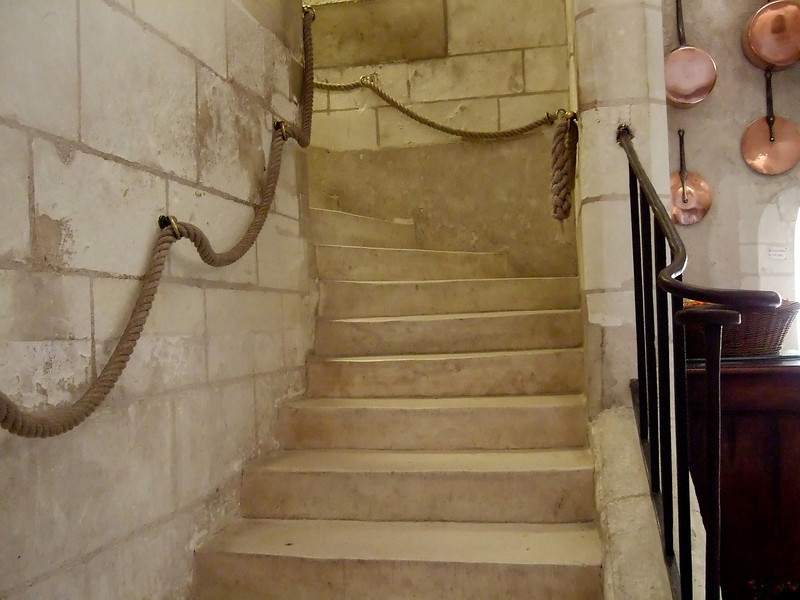 Stairs from the Kitchen area to the main level at Chateau Chenonceau