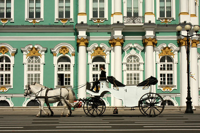 A horse drawn carriage in front of the Winter Palace.  the palace currently houses the Hermitage Museum, but was Russia's Imperial Palace from the 1700's to the early 1900's - Saint Petersburg, Russia ... May 26, 2009 ... Photo by Rob Page III