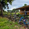 Bikes Along a Farm Fence