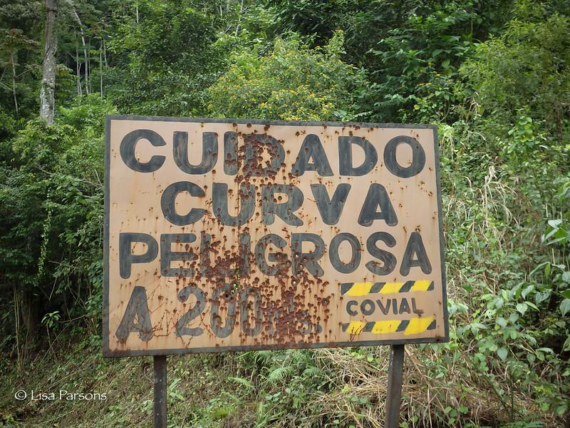 Cuidado Curva Peligrosa with Gun Shot Holes