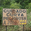 Cuidado Curva Peligrosa with Gun Shot Holes