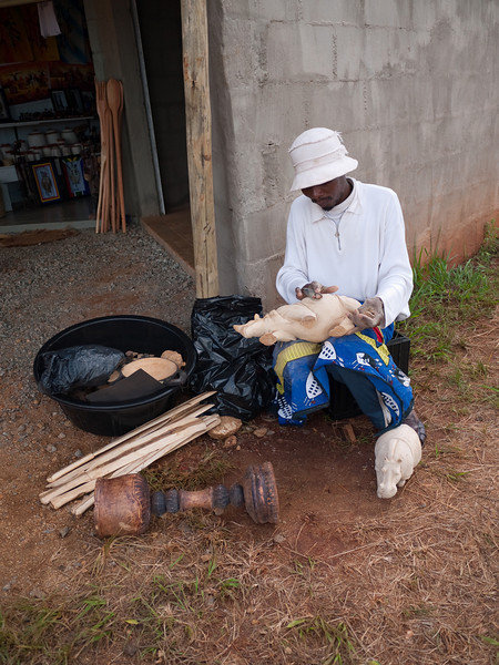 Hand Crafting a Rhinoceros for Sale at a Roadside Market in Swaziland