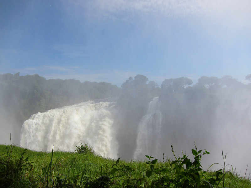 Victoria Falls in the mist on the Zambezi River between the countries of Zambia and Zimbabwe.
